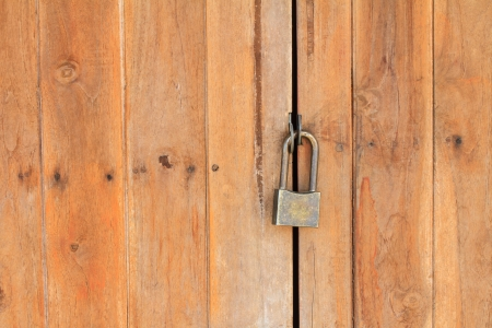 Padlock on old wooden wall Stock Photo - 22722536