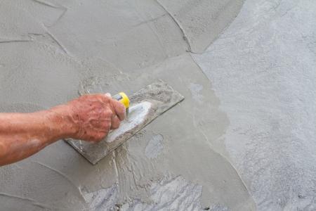 Truelle et béton frais sur la construction du site Banque d'images - 22722669