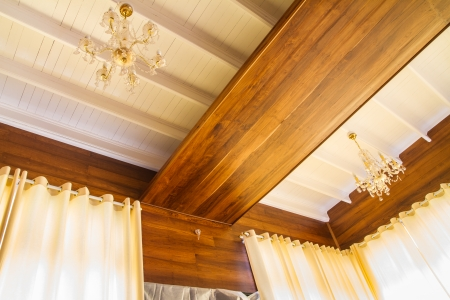Crystal chandelier on wooden ceiling
