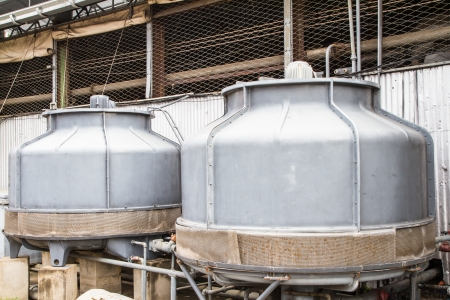 Small water cooling tower in factory  Stock Photo