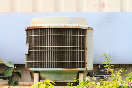 Old condensing unit of aircondition system behind small factory