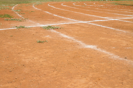 Running track on dirt road photo