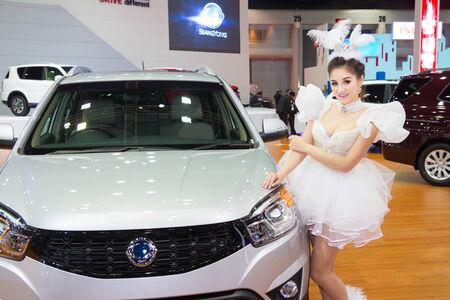 showed: Unidentified modelling post over Ssangyong Korando  showed in 35th Bangkok International Motor Show on March 25, 2014