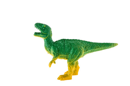 Plastic dinosaur toy isolated on white background photo