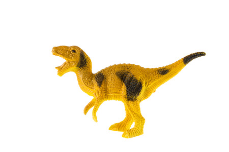 Plastic dinosaur toy isolated on white background, Velociraptor photo