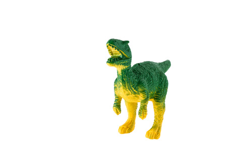 Plastic dinosaur toy isolated on white background, Tyrannosaurus photo