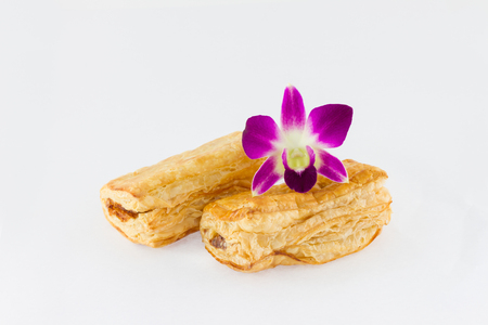 Tuna puff  and purple orchid on white background photo