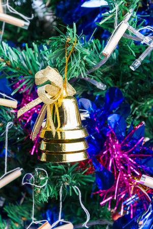 Golden bell on chrismas tree photo
