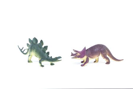 Triceratops and Stegosaurus dinosaur toy on white background photo