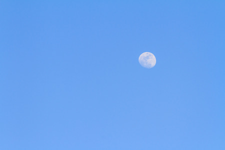 waxing gibbous: Moon on blue sky