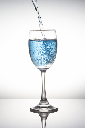 Blue wine glass on white background