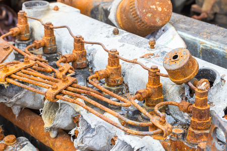 injector: old rusty injector and fuel pipe of diesel engine