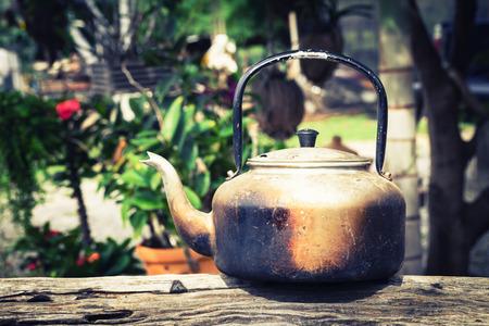 aluminium: Old aluminium kettle on timber in vintage