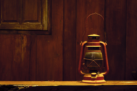 pressured: Hurricane lamp on wooden background in vintage
