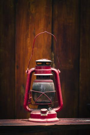 hurricane lamp: Still life of old hurricane lamp on wooden background Stock Photo
