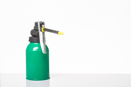 lubricator: green oil can on white background