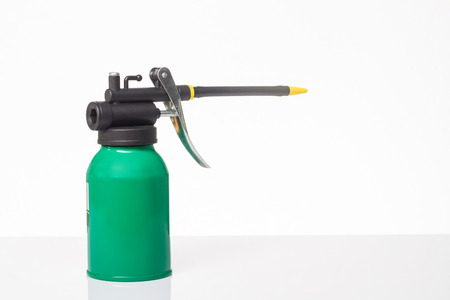 lubricate: green oil can on white background