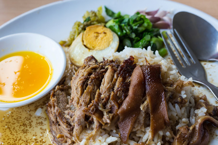 thai food: Stewed pork leg on rice with garlic and kale Stock Photo