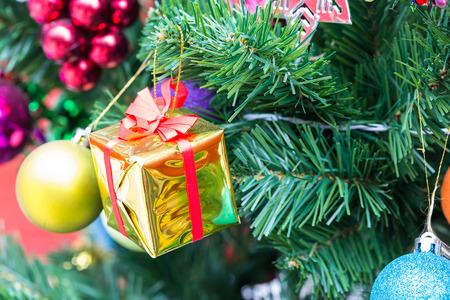cristmas: Gift and ball on cristmas tree Stock Photo
