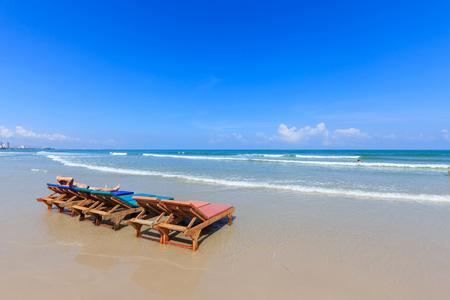 hua hin: Wooden chairs on Hua Hin beach and blue sky, Thailand Stock Photo