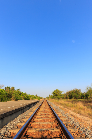 itinerary: railway tracks with blue sky  in the evening,Thailand Stock Photo