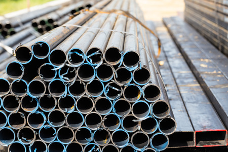 oxidize: Stack of steel pipes at construction site