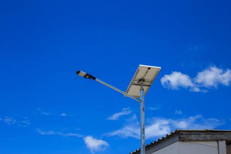 led lighting: LED street lighting power supply solar cells against blue sky Stock Photo