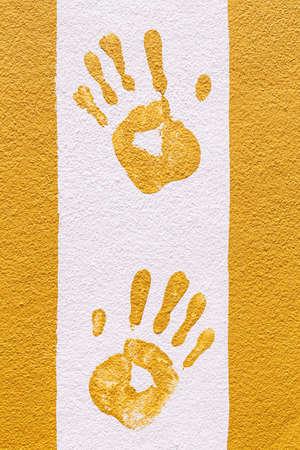 hand print: Hand print on orange and white wall