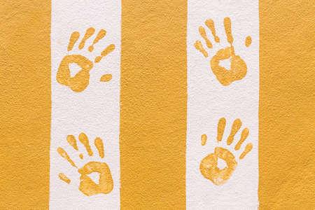 hand print: Hand print on orange and white wall background