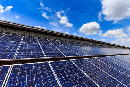 Solar cell on roof top against blue sunny sky., alternative energy