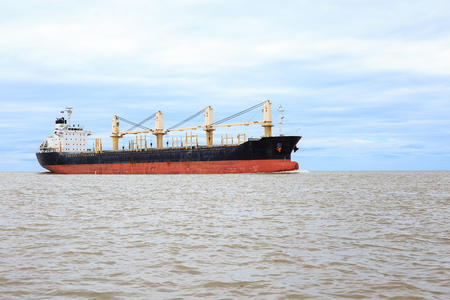 unloading: Large container ship in the sea., unloading
