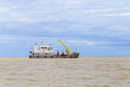 tender: Buoy tender boat in estuary Chao Phraya River., Thailand Stock Photo