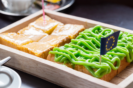 Bread custard on wooden plate with star flag Stock Photo
