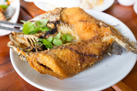calcarifer: Fried snapper topped with sweet fish sauce with herbs
