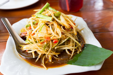 Green papaya salad  well  known in thai is SOM-TAM with banana leaf