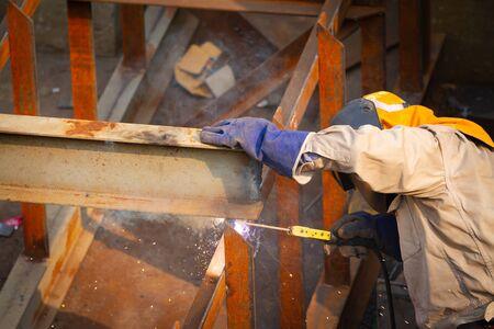 Industrial welder welding fabricated construction in factory
