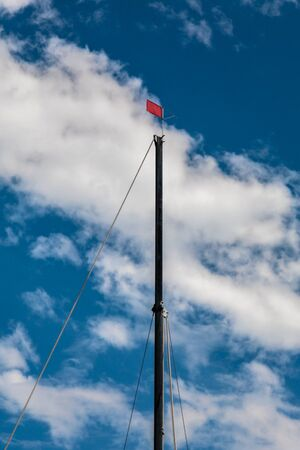 mast: Sailboat Mast With Wind Indicator On Top Stock Photo