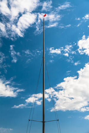apparent: Sailboat Mast With Wind Indicator On Top Stock Photo