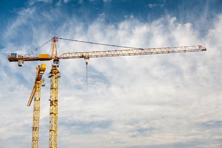 Construction tower cranes cloudy blue sky