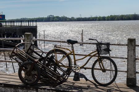 bike in pier the banks of the river parana Reklamní fotografie