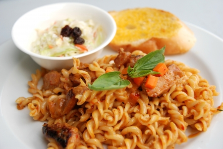 fusilli spicy red curry sauce photo