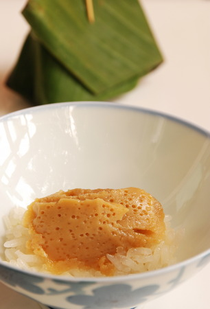 Egg custard with sweet sticky rice, exotic Thai sweet photo