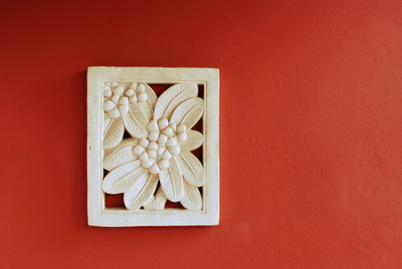 stone Bas-relief of frangipani flower, Thailand photo