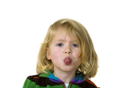 Young girl sticking out her tongue at you