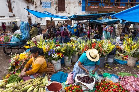 pisac: Pisac, Peru - December, 2013: Locals in a market in the city of Pisac, in the Sacred Valley.