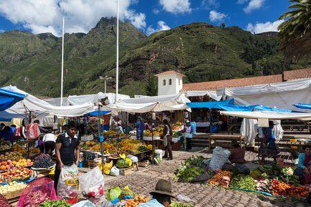 sacred valley: Pisac, Peru - December, 2013: Locals in a market in the city of Pisac, in the Sacred Valley.