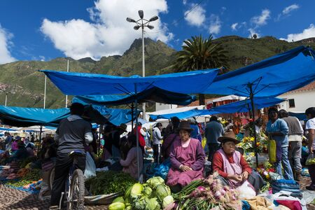 pisac: Pisac, Peru - December, 2013: Locals in a market in the city of Pisac, in the Sacred Valley.