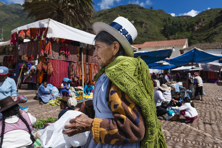pisac: Pisac, Peru - December, 2013: Local woman in a market in the city of Pisac, in the Sacred Valley. Editorial