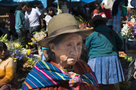 sacred valley: Pisac, Peru - December, 2013: Local woman in a market in the city of Pisac, in the Sacred Valley. Editorial