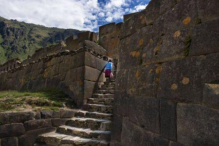 inca ruins: Ollantaytambo, Peru - December, 2013: Local woman in the Ollantaytambo Inca ruins, in the Sacred Valley, Peru